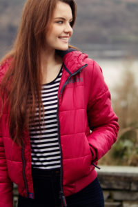 Girl wearing red puffer jacket and navy stripe top