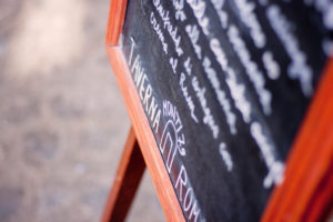 White writing on chalkboard. Restaurant Taverna Rome Italy