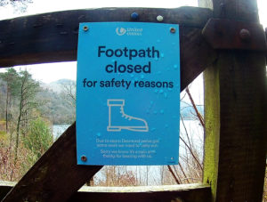 Blue sign saying footpath closed for safety. Lake District UK