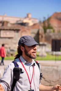 Bearded male with blue cap. Tour guide Rome Italy.