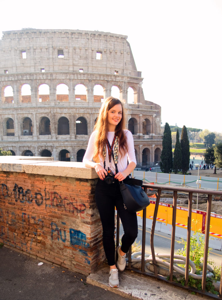 Female tourist photographer at Colosseum rome