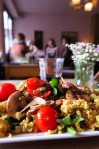 Plate of vegetarian food tomato rice peppers mushroom