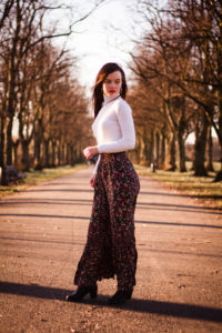Female model in park wearing long floral skirt
