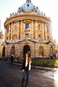 Young woman stood in front of Radcliffe Camera Oxford