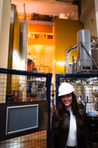 Young woman wearing hard hard inside JET Fusion Reactor Building Culham