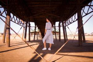 Young woman stood under St Annes pier Lancashire