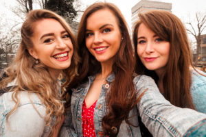 Group of long-haired young women taking selfie
