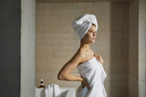 Girl wearing white bath towel