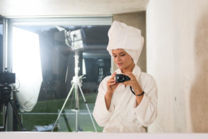 Female model wearing white bathrobe and towel wrapped around head