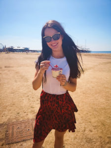 Young woman eating Notarianni ice-cream Blackpool beach
