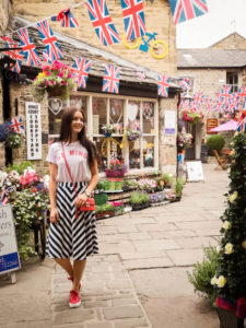 Young woman stood under bunting flags