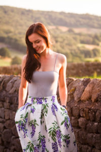 Girl wearing lilac floral skirt from Joanie clothing