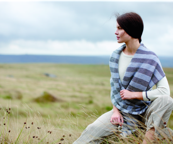Young woman wearing striped scarf on Yorkshire moors